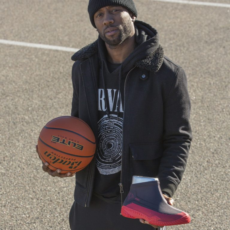 Man holding FY-DENY basketball shoe cover