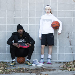 Friends holding FY-DENY basketball shoe cover