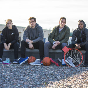 Friends sitting on wall next to FYVFY shoe covers