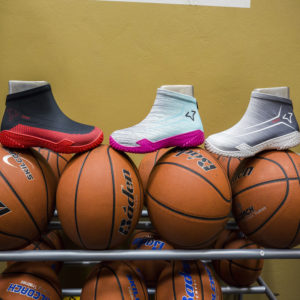 FYVFY's basketball shoe covers on top of basketballs
