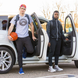 Basketball players arriving at court wearing baksetball shoe covers