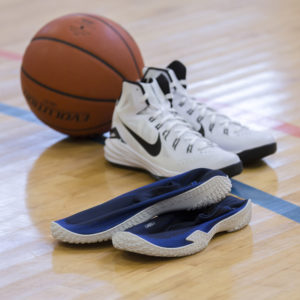 FY-DENY basketball shoe covers next to basketball shoes