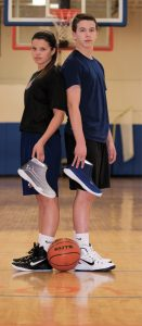 Friends holding FY-DENY basketball shoe covers