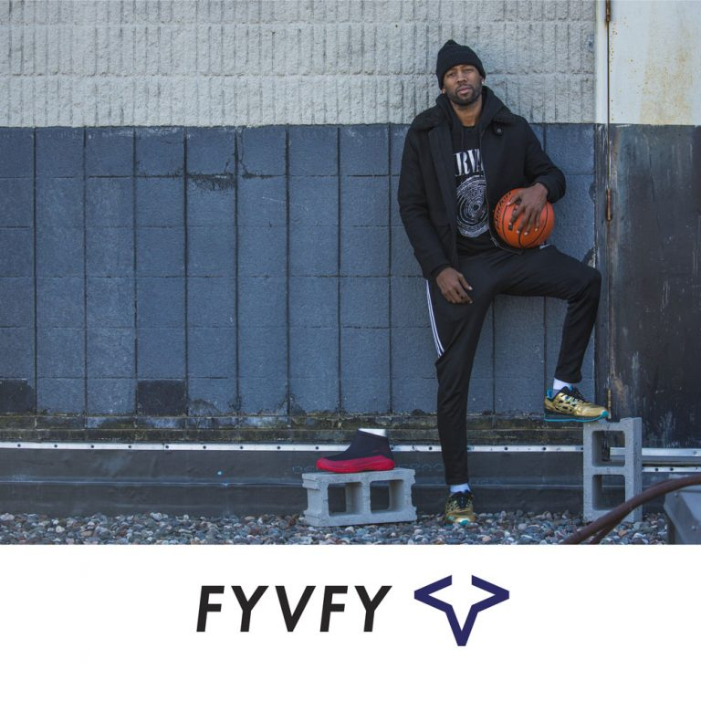 Man holding basketball with FYVFY shoe cover
