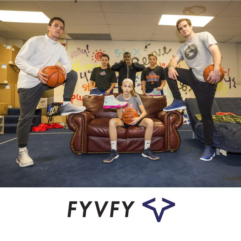 Group of friends holding basketball shoe covers