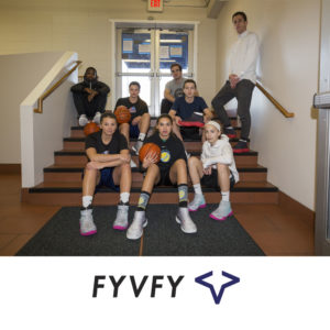 Group sitting on staircase of basketball court